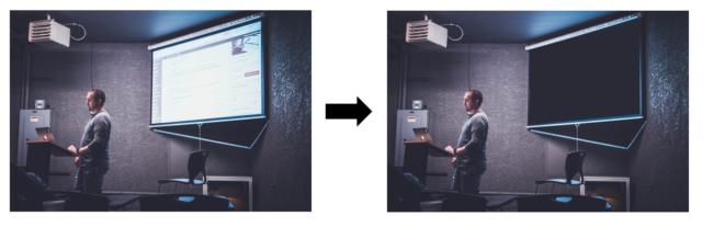 En man som håller en presentation med projektorn släckt.